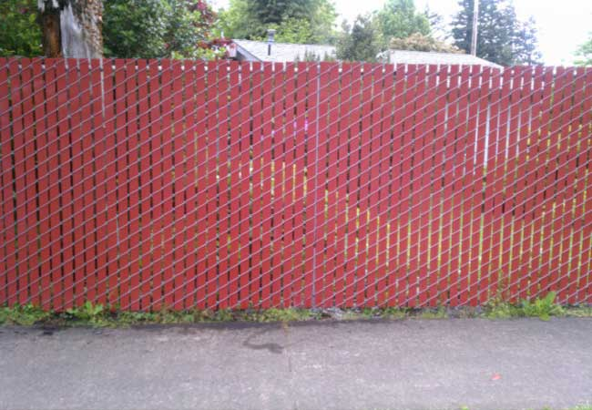 red slats in chain link privacy fencing