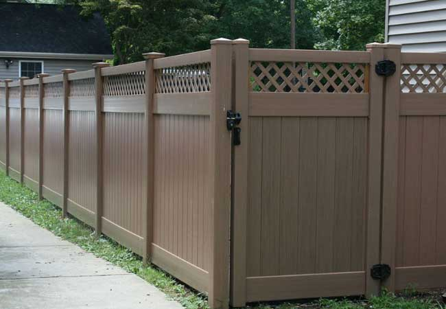 brown vinyl open top privacy fencing and gate